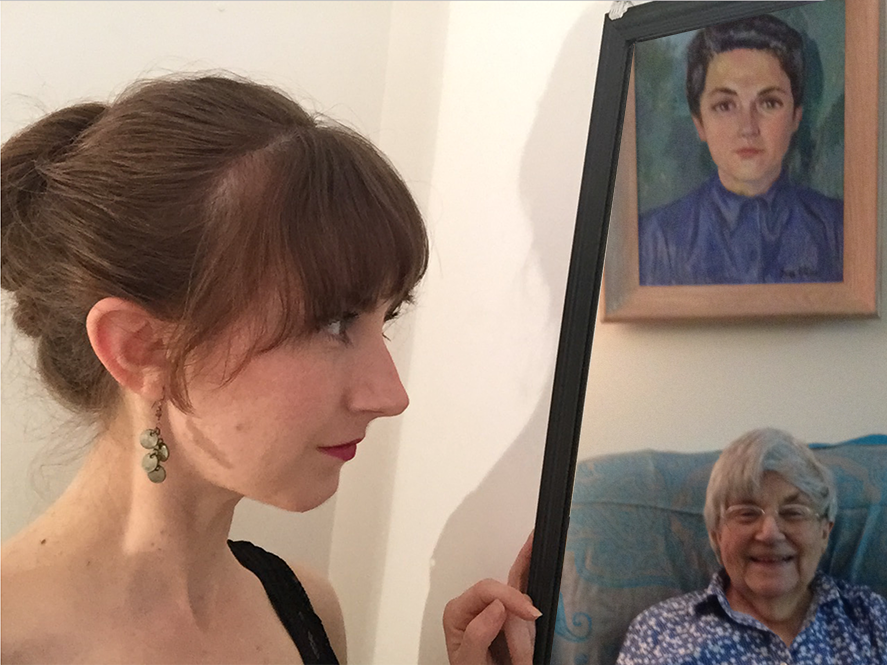 a photo of the author regarding an image of her grandmother sitting under a portrait of her grandmother's younger self.